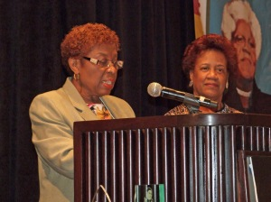 Dr. Janet Sims-Wood, Librarian (right, standing in front of Mrs. Bethune), Prince George's Community College, Maryland Receiving the Mary McLeod Bethune Award at the 97th Annual Conference of the Association for the Study of African American Life and History, from Dr. Annette Palmer (left).  Photograph by Allen Jackson.